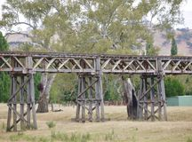 The historic railway bridge at Gundagai. The rail bridge at Gundagai over the Murrumbidgee river and floodplain is a spectacular latticework of wooden trusses in Stock Images