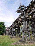 The historic railway bridge at Gundagai. The rail bridge at Gundagai over the Murrumbidgee river and floodplain is a spectacular latticework of wooden trusses in Royalty Free Stock Image