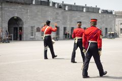 Historic re-enactment soldiers marching in a parade square royalty free stock images