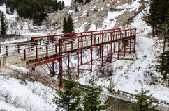 Historic Red Bridge. The Dearborn River High Bridge, built in 1897 and restored in 2003, is the last example of a pin-connected Pratt half-deck truss bridge in Stock Images