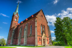 Historic red church in Zalesni Lhota, East Bohemia Stock Photography