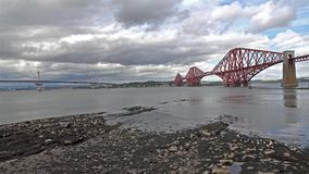 Historic red Forth Bridge in Edinburgh - Scotland - time lapse stock video footage