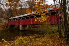 Historic Red Lower Humbert Covered Bridge - Somerset County, Pennsylvania. A scenic, autumn view of the red painted Lower Humbert Covered Bridge in Somerset Royalty Free Stock Photos