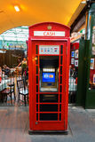 Historic red phone box used as a cash machine in London, UK Royalty Free Stock Photos