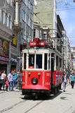 A historic red tram traveling between Taksim and Tunel. ISTANBUL,TURKEY-JUNE 7:A historic red tram traveling between Taksim and Tunel.June 7,2015 in Istanbul Royalty Free Stock Images