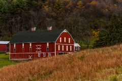 Historic & Scenic Red & White Barn on Appalachian Farm - Autumn Splendor - Somerset County, Pennsylvania. A historic red and white barn on a scenic farm Stock Image