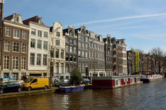 Historic residential buildings along Prinsengracht canal in Amsterdam Stock Images