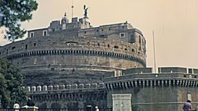 Sant`Angelo castle Rome. Historic restored footage in 1967. Castel Sant`Angelo castle in Rome city, Italy, located beside Tiber river. Ground street point of stock video footage