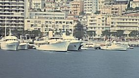 Monte Carlo port. Historic restored footage on 1960s of luxury boats and yachts. at the historical port Hercule in Monte Carlo, Monaco,France. In front of the stock footage