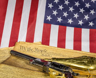 Historic revolver with constitution and American flag Stock Photo