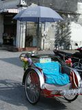 Historic Rickshaw. A man powered, historical conveyance for transporting people around the town of Georgetown, Malaysia Royalty Free Stock Photo