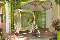 Historic Rickshaw. A man powered, historical conveyance for transporting people around the town of Georgetown, Malaysia Stock Photo