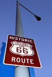 Historic Route 66. Historic route number 66 in california, blue background Royalty Free Stock Photos