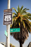 Historic route 66 highway sign. With palm tree and a blue sky royalty free stock image