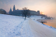 Historic royal Wawel Castle in Cracow, Poland, with frozen Vistula river in winter. Royalty Free Stock Photography