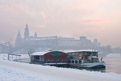 Historic royal Wawel Castle in Cracow, Poland, with frozen Vistula river in winter. Stock Photos