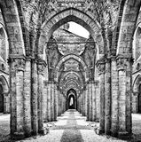 Historic ruins of an abandoned abbey in black and white Stock Image