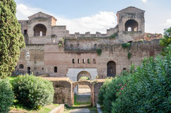 Historic ruins of a brick building with a metal fence Porta Asinaria in Rome, capital of Italy Stock Photo