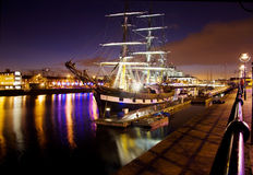 Historic sail ship docked in the city at night stock photos