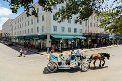 Historic San Antonio. San Antonio, TX USA - April 15, 2016: Visitors enjoying a horse carriage ride in the historic Alamo district stock photo