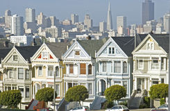 Historic San Francisco. Alamo Square, victorian architecture and San Francisco skyline Royalty Free Stock Image