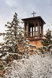 Historic Santa Fe Church Steeple Stands over snow  Royalty Free Stock Photos