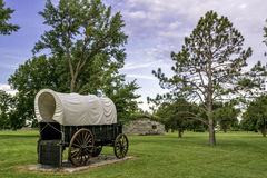 Historic scene with covered wagon and bunk house Royalty Free Stock Photos