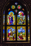 Historic scenes on a stained window. Stock Image