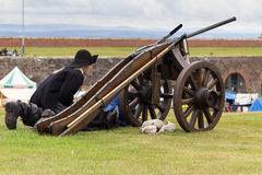 Historic Scottish Soldier and cannon Royalty Free Stock Images