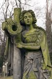 Historic Sculpture from the mystery old Prague Cemetery, Czech Republic. Historic Sculpture from mystery old Prague Cemetery, Czech Republic Stock Photography