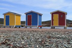 Different colored fishing sheds Royalty Free Stock Image