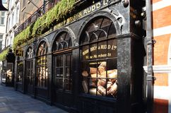 Historic shop of Berry Bros. & Rudd in London. View to a historic alley with the shopwindow of Berry Bros. & Rudd with oversized wine corks - London, Great Royalty Free Stock Image