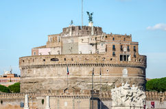 Historic sights of building architecture Castel Sant'Angelo in Rome, on the banks of the Tiber River near the arched bridge across Royalty Free Stock Images