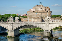 Historic sights of building architecture Castel Sant'Angelo in Rome, on the banks of the Tiber River near the arched bridge across Stock Photography