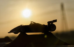 Historic single-seater with sunset in background Stock Images