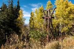 Historic ski lift tower amid Autumn leaves Royalty Free Stock Photo