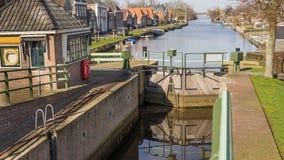 Historic sluice in a small Dutch village Stock Photo