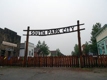 Historic South Park City Sign hangs in the air above wood fence Stock Photos