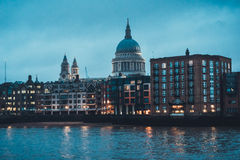 Historic St Pauls Cathedral and London Skyline. Dome and Spires of Historic St Pauls Cathedral Above Low Rise Waterfront Buildings Along Thames River, as part of Royalty Free Stock Photo