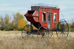 Historic Stage Coach Sits In A Field Royalty Free Stock Image