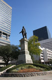 Historic statue and cityscape Royalty Free Stock Image