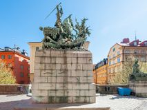 Saint George and the Dragon in Stockholm. Historic statue of Saint George and the dragon in medieval Old Town of Stockholm during spring in Sweden. The historic Royalty Free Stock Image