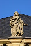 Historic statue on top of the fassade of Margrave Opera House in Bayreuth, Germany. Historic statue on top of the facade of Margrave Opera House (MARKGRÄ Royalty Free Stock Photos