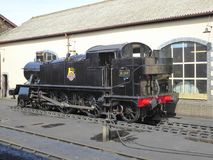 Historic steam locomotive at depot royalty free stock photography