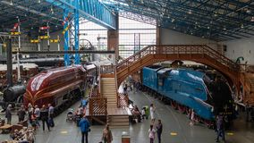 Historic steam locomotives and coaches in the National Railway Museum, York.