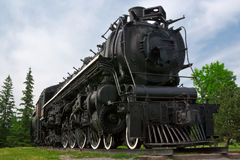 Historic Steam Powered Freight Train. An historic 4-8-4, or Northern type steam train engine built by The Montreal Locomotive Works for Canadian National Royalty Free Stock Photography