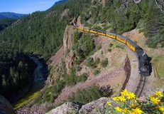 A steam train along a river in Colorado. A historic steam train rolls along a river in Colorado Stock Photos