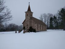 Historic Stone Church in Snow Royalty Free Stock Photography