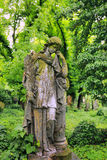 Historic stone Girl on Tomb from old Prague Cemetery, Czech Republic Stock Images