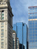 Historic Stone and Modern Glass Buildings Royalty Free Stock Photography